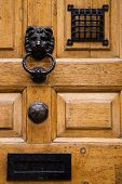 picture of front-entry  - details on a wooden front door with a nice door knocker - JPG