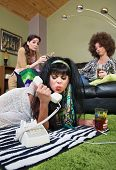 picture of sulky  - Sulky mature white female holding phone and drink - JPG