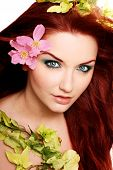 pic of red hair  - A beautiful young woman with flowers in her hair - JPG