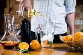 foto of sangria  - Man pouring white wine into a jar - JPG