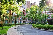 stock photo of driveway  - Circular driveway and sidewalk at brick condominium building - JPG