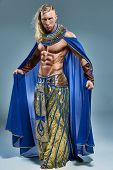 foto of pharaoh  - The man in the image of the ancient Egyptian Pharaoh  on blue background - JPG