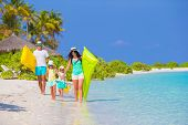 pic of children beach  - Happy beautiful family on a beach during summer vacation - JPG