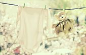 picture of clotheslines  - Baby clothes hanging on the clothesline - JPG