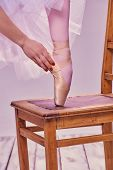 picture of ballet shoes  - Professional ballerina putting on her ballet shoes - JPG