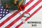 foto of memorial  - USA Memorial Day concept with dog tags and red remembrance poppy on American stars and stripes flag on white vintage wood table with title text - JPG