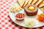 image of yolk  - tartare meat with egg yolk - JPG