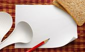 stock photo of ladle  - Blank white sheet of paper with ladles and bread - JPG
