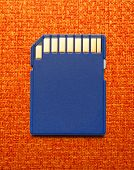 pic of memory stick  - Blue compact memory card for camera in closeup - JPG