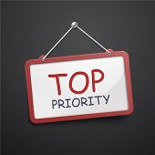 stock photo of priorities  - top priority hanging sign isolated on black wall - JPG