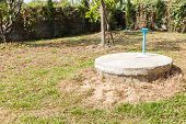 foto of septic  - underground cement cylinder of lavatory cesspit in lawn yard - JPG