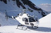image of helicopters  - White rescue helicopter parked in the snowy mountains - JPG