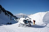 image of rescue helicopter  - White rescue helicopter parked in the snowy mountains - JPG