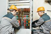 picture of electrical engineering  - electrician builder engineer workers with electric cable wiring of fuse switch box - JPG