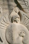 image of funeral home  - to angels in stone watching over a cemetary - JPG