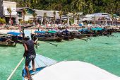 picture of phi phi  - the main pier of the tropical thai island named Phi Phi with a lot of colorful longtail boats - JPG