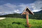 stock photo of crucifix  - Wood crucifix in a mountain landscape - JPG