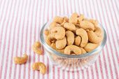 picture of salt-bowl  - closeup of salted cashews nuts in glass bowl - JPG