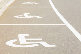 stock photo of handicapped  - Outdoor empty space car parking for handicap person - JPG