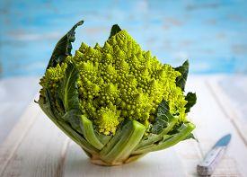 image of romanesco  - A head of Romanesco broccoli on on chopping board - JPG