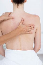 pic of shoulder-blade  - Physiotherapist doing back massage in medical office - JPG