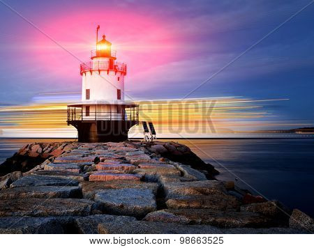 Lighthouse on top of a rocky island slow exposure with added lens flare, Lighthouse on top of a rocky island slow exposure with added lens flare