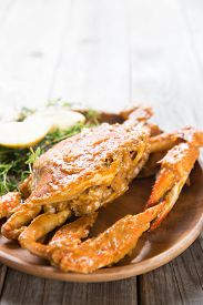 foto of cooked crab  - Close up cooked delicious hot and spicy sauce blue crab - JPG