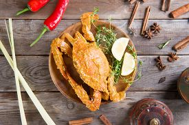 foto of cooked crab  - Above view cooked delicious hot and spicy sauce blue crab and ingredients - JPG