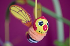 foto of jousting  - Little bee hanging above baby bed - JPG