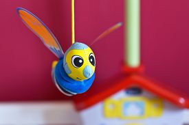 pic of jousting  - Little bee hanging above baby bed - JPG