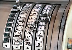 picture of levers  - Vintage cash register with columns of numbers in different denominations with manual metal levers to record the amount or price - JPG