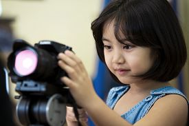 picture of little girls photo-models  - Little Asian girl photographerlooking and take the photo by your camera - JPG