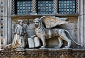 picture of porphyry  - The Venetian lion and Doge on a cathedral building on San Marco square - JPG