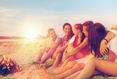 friendship, happiness, summer vacation, holidays and people concept - group of smiling friends sitti poster
