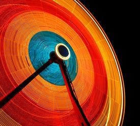 picture of ferris-wheel  - Ferris Wheel spinning in dark night sky - JPG
