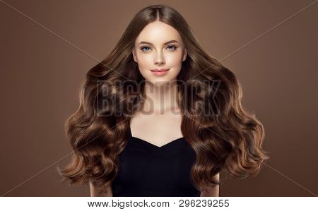 poster of Beauty Girl With Long  And   Shiny Wavy Hair Chocolate Color .  Beautiful   Woman Model With Curly H