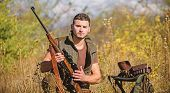 Man With Rifle Hunting Equipment Nature Background. Hunting Equipment And Safety Measures. Prepare F poster