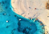 Aerial View Of The Fishing Boats On Tropical Sea Coast With Sandy Beach At Sunset. Fishing Village O poster