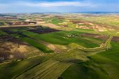 Aerial, drone view of endless lush pastures and farmlands with green fields and meadows. poster