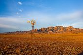 A Windmill With The Flinders Ranges Behind It In The Australian Outback. Flinders Ranges National Pa poster