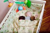 Babys Restful Sleep. Newborn Baby In A Wooden Crib. The Baby Sleeps In The Bedside Cradle. Safe Livi poster