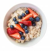 Homemade Oatmeal With Blueberries And Strawberries In Bowl Isolated On White Background. Healthy Bre poster