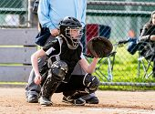 Female Softball Catcher In Full Protective Gear Ready To Catch The First Pitch. poster