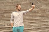 Selfie Concept. Handsome Man Take Selfie With Smartphone. Athletic Guy Use Mobile Phone For Selfie.  poster