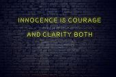 Positive Inspiring Quote On Neon Sign Against Brick Wall Innocence Is Courage And Clarity Both. poster