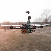 A Small Fpv Racing Drone Is Ready To Fly And Hovered Above The Ground Before The Race. Self-made Fly poster
