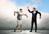 stock photo of slave  - Image of businesspeople hanging on strings like marionettes - JPG