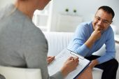 stock photo of psychological  - Female psychologist consulting mature man during psychological therapy session - JPG