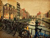 Amsterdam. The Singel is one of the numerous canals in Amsterdam, Netherlands.  Photo in retro styl