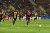 KUALA LUMPUR - AUGUST 10: FC Barcelona's Alexis Sanchez (maroon/blue) leads in attack against the Ma